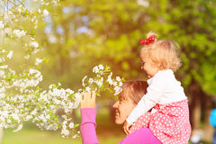 Mother and little daughter enjoy spring blossom stock images