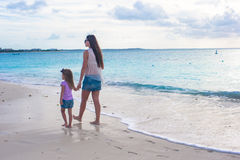 Mother and little daughter at exotic beach on Royalty Free Stock Images