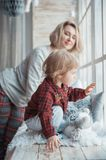 Mother with a little daughter. Family in home clothes royalty free stock photo