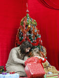 Mother with little daughter finding christmas gifts Royalty Free Stock Photos
