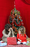 Mother with little daughter finding christmas gifts Royalty Free Stock Image