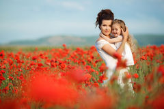 Mother and little daughter in the flower field Stock Photos
