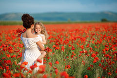Mother and little daughter in the flower field Stock Image