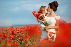 Mother and little daughter in the flower field Royalty Free Stock Photo