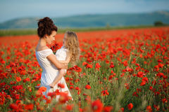 Mother and little daughter in the flower field Royalty Free Stock Photography