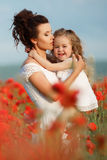 Mother and little daughter in the flower field Stock Photo
