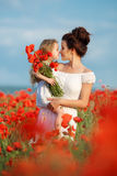 Mother and little daughter in the flower field Stock Images