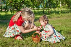 Mother and little daughter in garden Stock Images