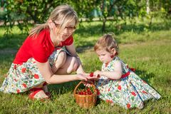 Mother and little daughter in garden Stock Photos