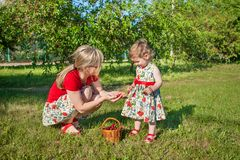 Mother and little daughter in garden Royalty Free Stock Photo