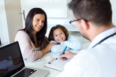 Mother with little daughter having consultation at pediatrician office. Royalty Free Stock Photo