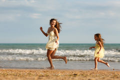 Mother and little daughter are having fun on the beach. Portrait of mother and little daughter are having fun on the beach. Happiness and enjoyment Royalty Free Stock Photo