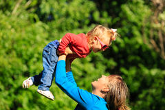 Mother and little daughter having fun in summer Stock Photography