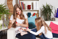 Mother and little daughter having girly time Royalty Free Stock Photo