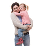 Mother with little daughter in her arms hugging Stock Image