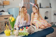 Mother with little daughter in a kitchen royalty free stock photography