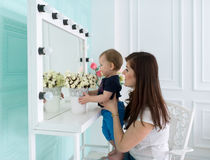 Mother with the little daughter look in a mirror. Stock Image