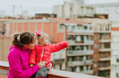 Mother and little daughter looking at the city Stock Photos