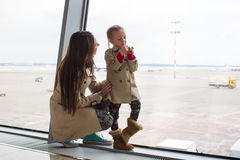 Mother and little daughter looking out the window Royalty Free Stock Image
