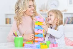 Mother with little daughter making figures with constructor Royalty Free Stock Image