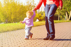 Mother and little daughter making first steps in Royalty Free Stock Photos