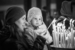 Mother with little daughter in Orthodox Church Stock Photography