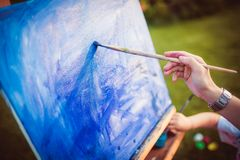 Mother and little daughter paint together Royalty Free Stock Photo