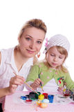 Mother and little daughter painting easter eggs Royalty Free Stock Photo