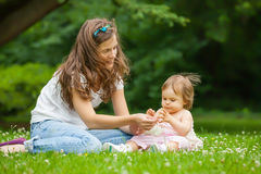 Mother and little daughter in the park Royalty Free Stock Image