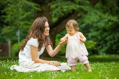 Mother and little daughter in the park Stock Photos