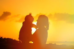 Mother and little daughter play at sunset Royalty Free Stock Image