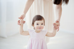Mother and little daughter playing in the bedroom Royalty Free Stock Images