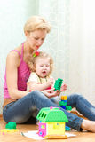 Mother with a little daughter playing. With blocks Royalty Free Stock Image