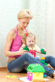 Mother with a little daughter playing. With blocks Royalty Free Stock Photography