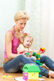 Mother with a little daughter playing. With blocks Stock Photography
