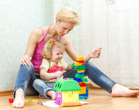 Mother with a little daughter playing. With blocks Royalty Free Stock Photos