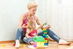 Mother with a little daughter playing. With blocks Stock Images