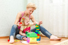 Mother with a little daughter playing. With blocks Royalty Free Stock Photo