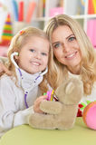 Mother with little daughter playing Royalty Free Stock Image