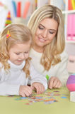 Mother with little daughter playing Royalty Free Stock Photography