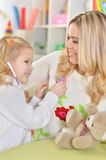 Mother with little daughter playing Royalty Free Stock Images