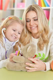 Mother with little daughter playing Stock Images
