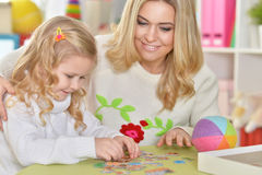 Mother with little daughter playing Royalty Free Stock Photos