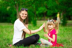 Mother and little daughter playing together in park. Outdoor Portrait of happy family. Happy Mother`s Day Joy. stock photography