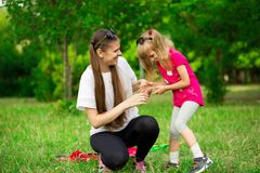 Mother and little daughter playing together in park. Outdoor Portrait of happy family. Happy Mother`s Day Joy. royalty free stock photography