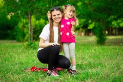 Mother and little daughter playing together in park. Outdoor Portrait of happy family. Happy Mother`s Day Joy. royalty free stock image