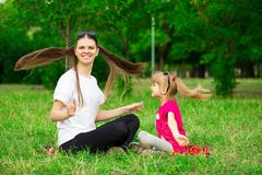 Mother and little daughter playing together in park. Outdoor Portrait of happy family. Happy Mother`s Day Joy. royalty free stock photos