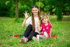 Mother and little daughter playing together in park. Outdoor Portrait of happy family. Happy Mother`s Day Joy. stock photo