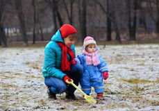 Mother and little daughter playing in winter Stock Image