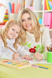 Mother with little daughter Stock Image